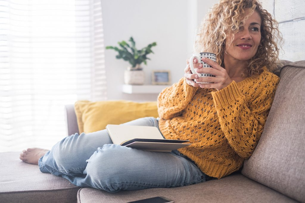 woman with healthy skin relaxing at home