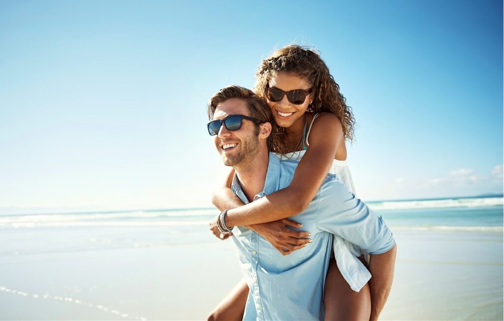 Man and Woman Couple Enjoying the Beach in the Summer